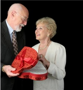 man and woman with box of chocolates