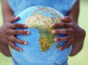 globe held by hands