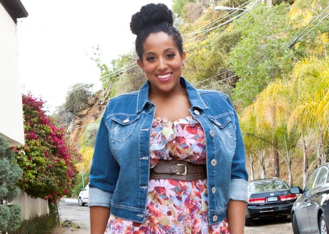 Plus size cropped denim jacket over a plus size chiffon dress with flower print.