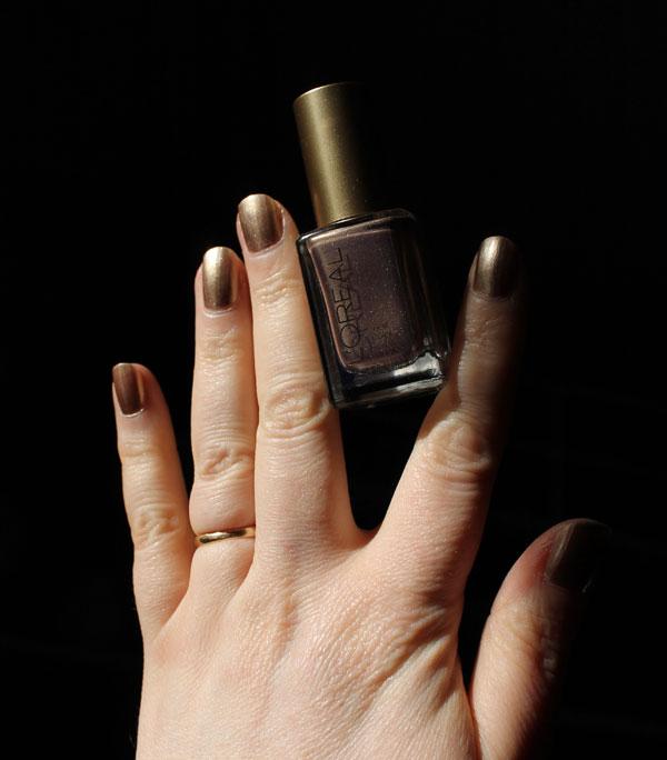 Gold nail polish by L'Oreal Paris.
