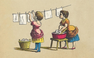 Two women hanging laundry.