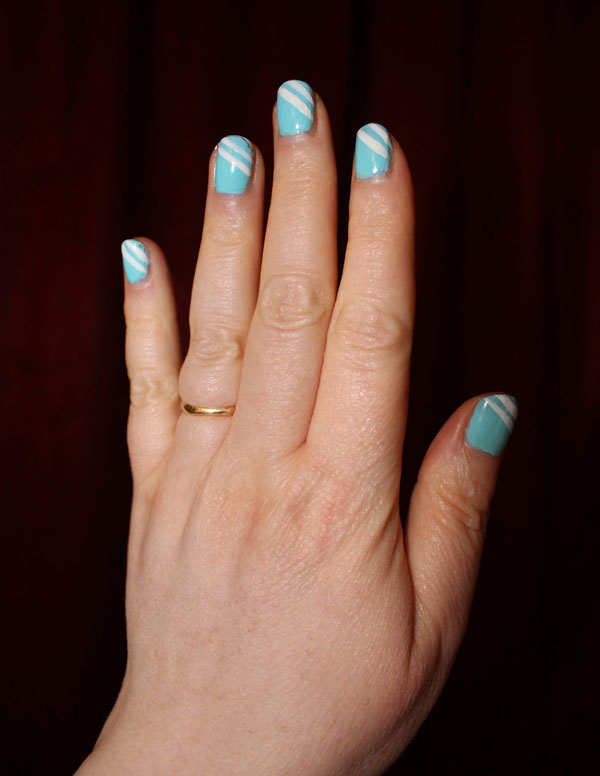 Bright blue nail polish with two thin white stripes on tips.