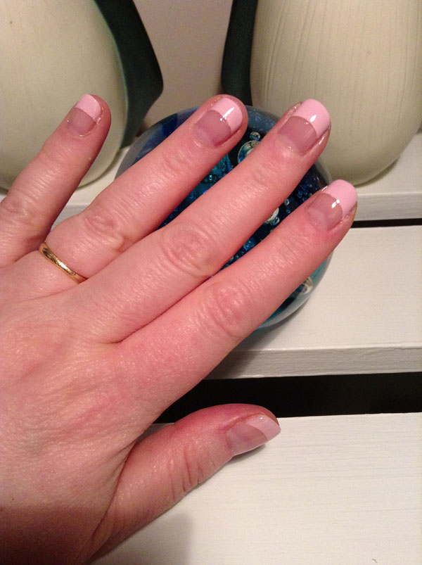 Pink tipped french manicure.