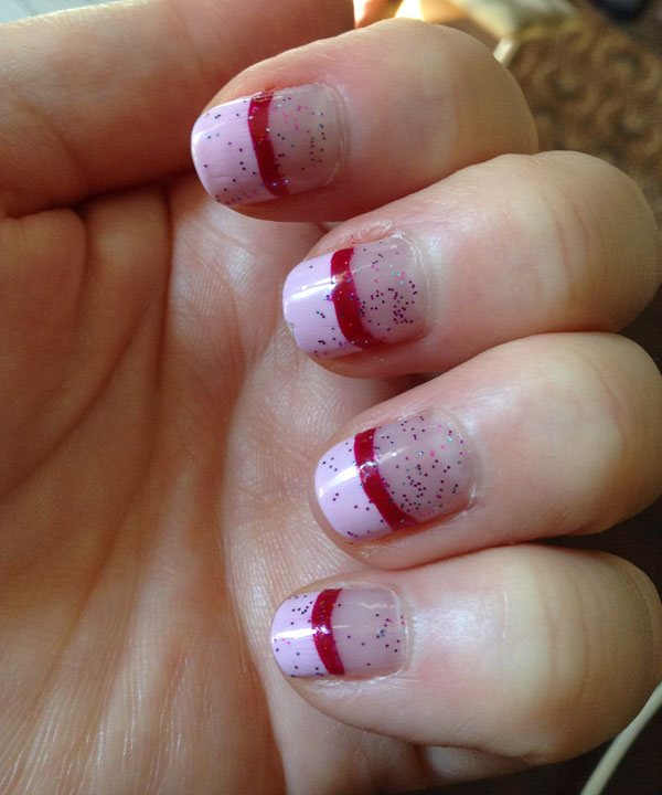 Pink french manicure with sparkle top coat.