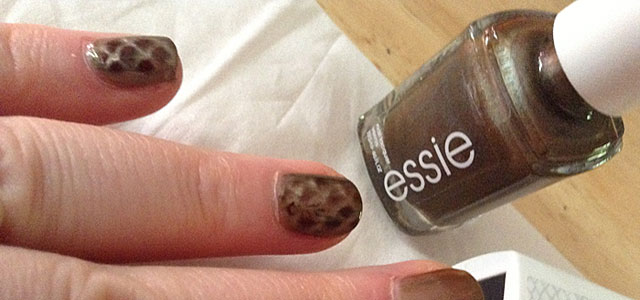 Bronze colored magnetic nail polish from Essie with a reptile print inlay effect.