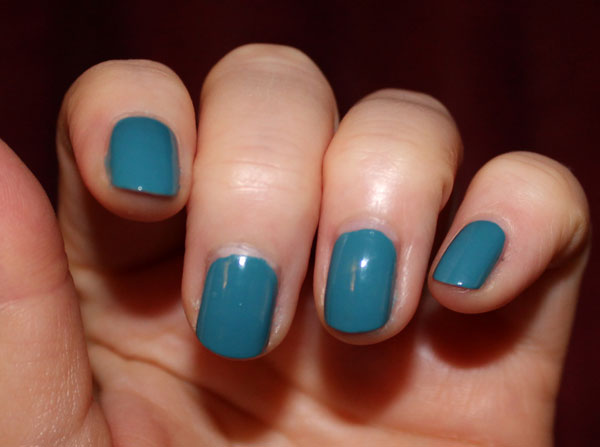 Teal nail polish from Avon on my nails.