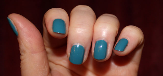 Teal blue green nail polish from Avon.