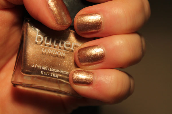 Rose gold nail polish from Butter London -- artificial light.