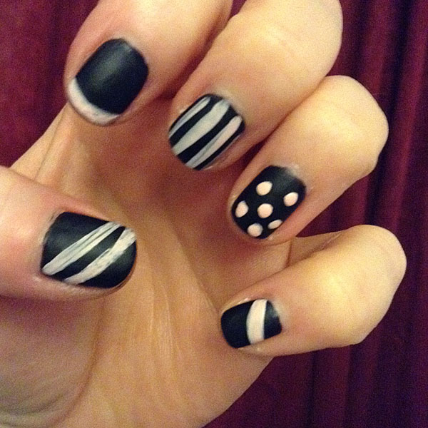 Different patterns on each finger with chalkboard nail base.