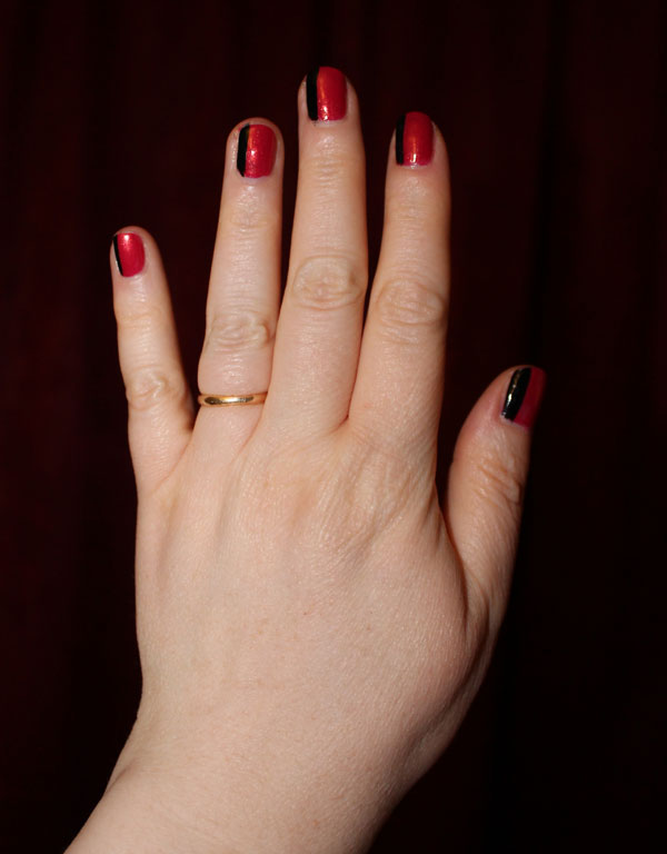 Black and red color blocking nail art.