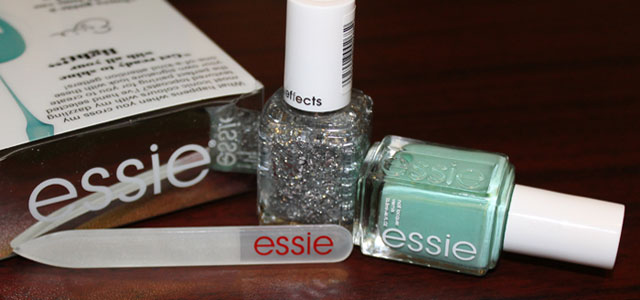 Light green nail polish with silver glitter topcoat.