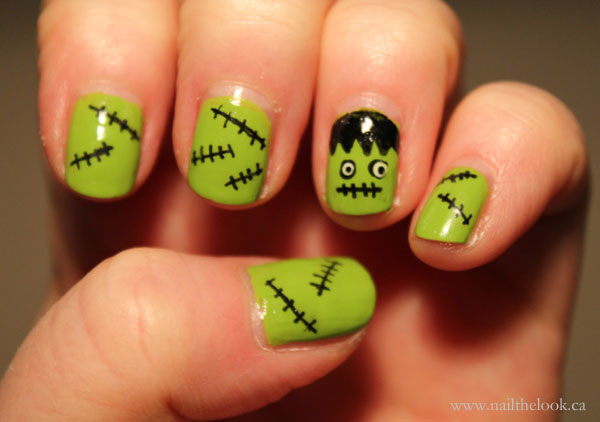 Cute nail art with Frankenstein accent nail and stitches on green flesh.