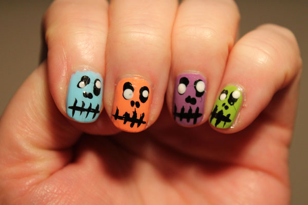 Colorful ghoul Halloween nail art for fall.