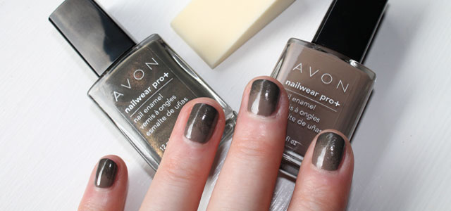 Beige nail polish with sponge green accent tips.