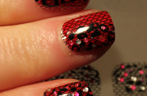 A close up of the Racy Lacy Avon nail strips.