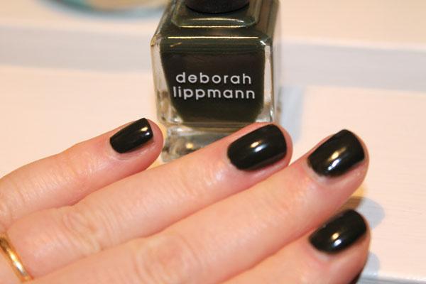 Deborah Lippmann's Billionaire nail polish under artificial lighting.