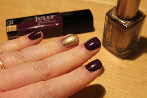 On my nails I have a dark purple by Julep called Gayle with a gold L'oreal accent nail.
