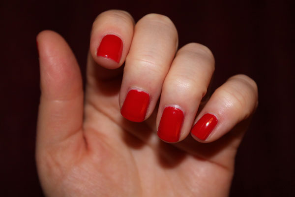 Showing off my red nail polish.