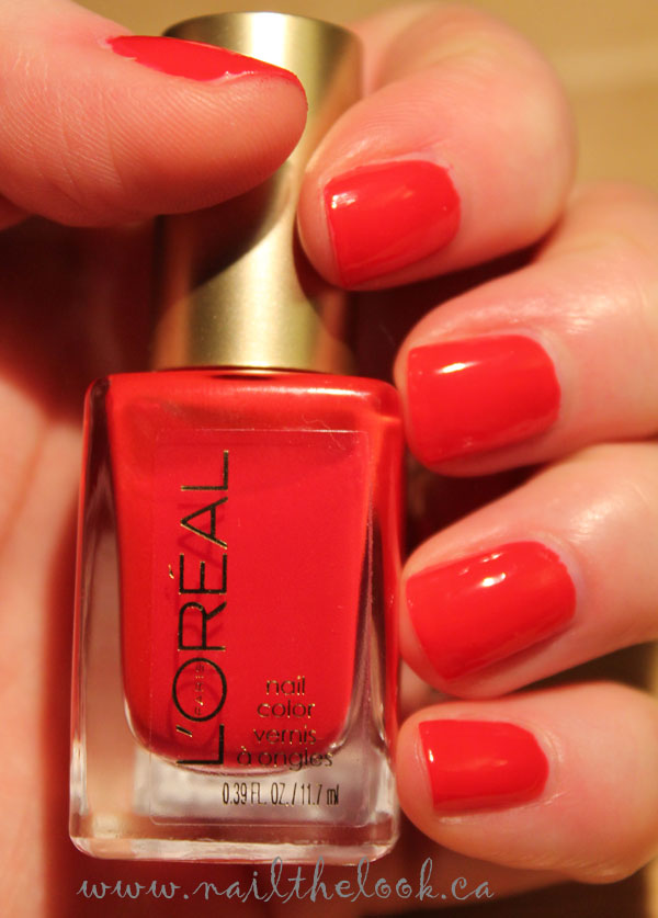 On my nails is L'Oreal's red Rendezvous.