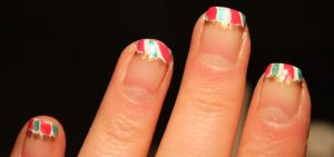 My review of a how-to video and my first attempt at candy cane Christmas nail art.