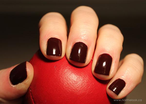 Dark red Essie nail polish under my lamp light