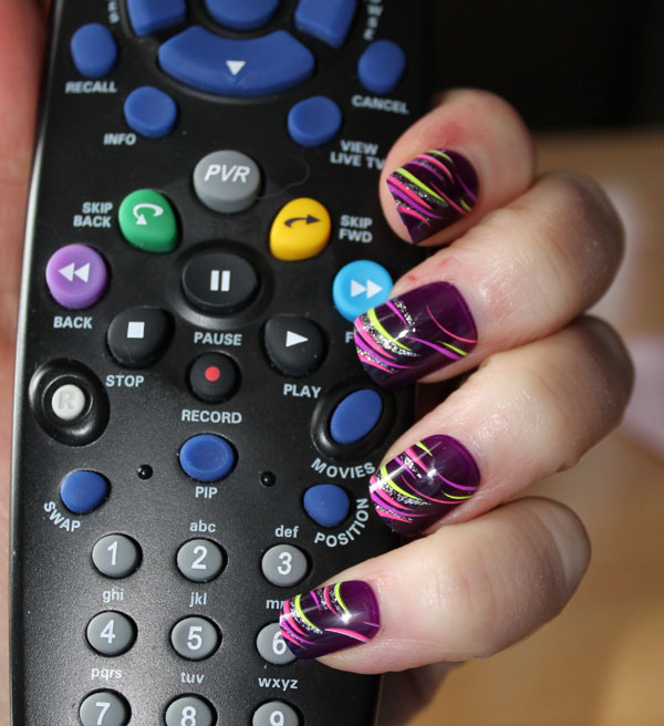 Holding my remote control with no interference from press-on nails.