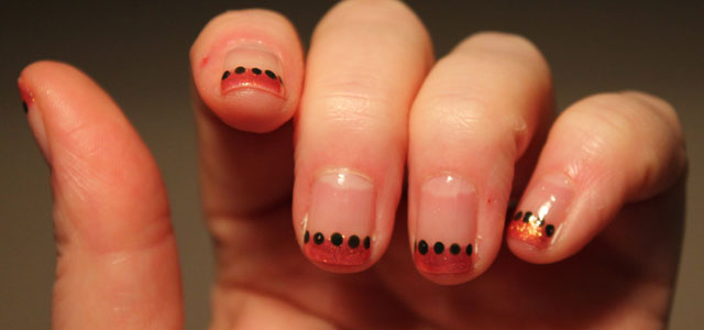 My featured nail art this month is sparkly orange tips with accent dots.