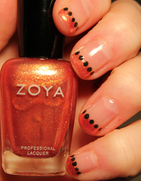 One of my all time favorite colors is this sparkly orange nail polish by Zoya.
