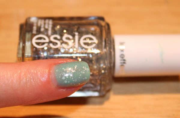My nails with Essie glitter sandwiched between Julep nail polish.