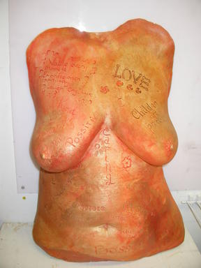 A breast casting decorated with color and words.