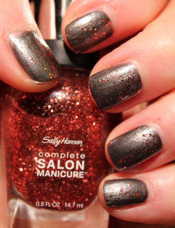 My nails with Copper Penny top coat on top of a steel from Revlon.