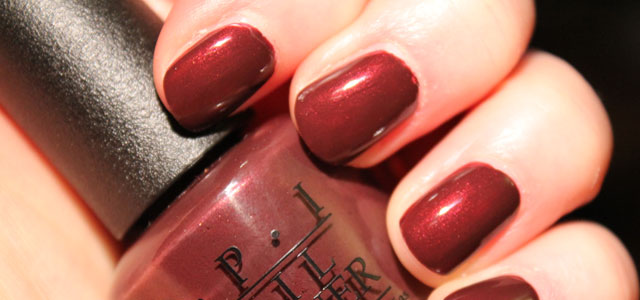 Playing with a little Sleigh Ride for Two dark red nail polish.
