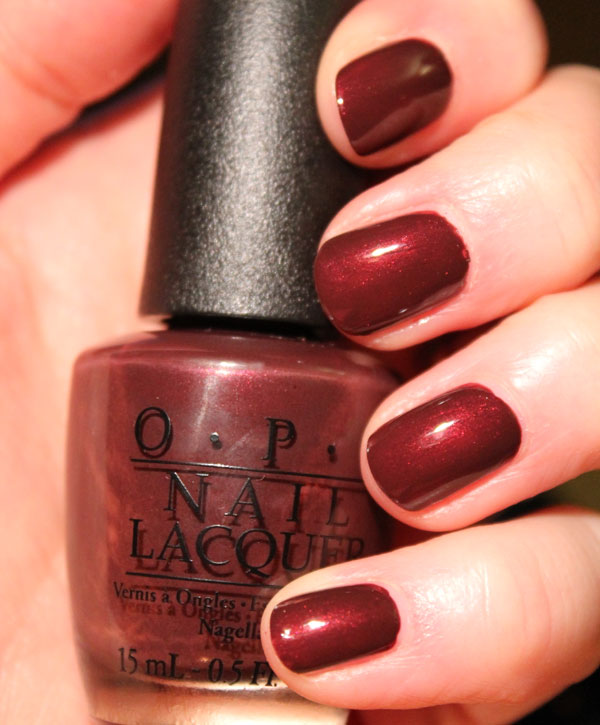 My nails are ready for the slopes with Mariah's deep red nail polish by OPI.