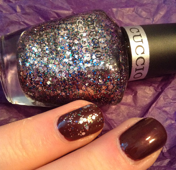 Adding a little sparkle to the accent nail with Cuccio's remix glitter nail polish.
