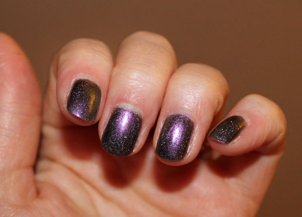 This holographic shimmer has a grape backdrop that shows off the shimmer nicely.