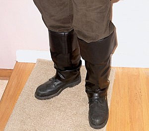 Buckeneer shoe covers for pirate costume are cut from lower legs.