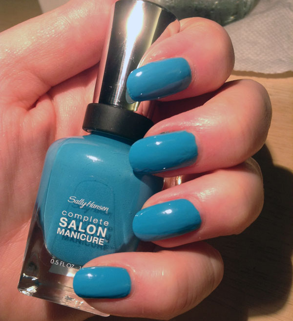 My nails with Water Color blue nail polish from Sally Hansen.
