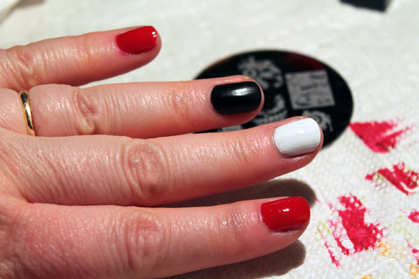 My third attempt at nail stamping with red, black and white.