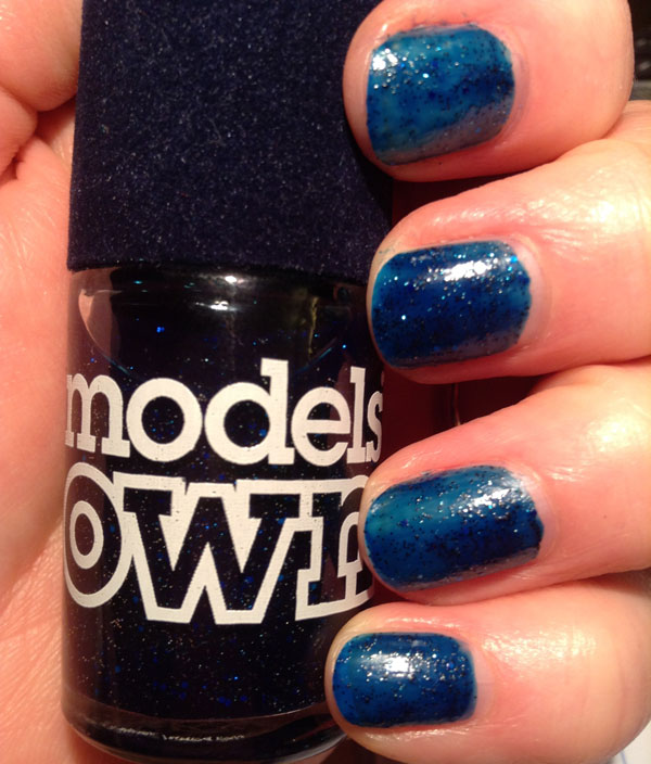 My nails with Models Own Valerian blue glitter nail polish.