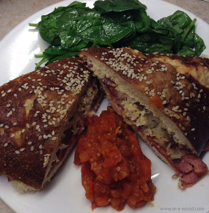 Corned Beef on a Pretzel bun with spinach salad and tomato jam via Chef's Plate.