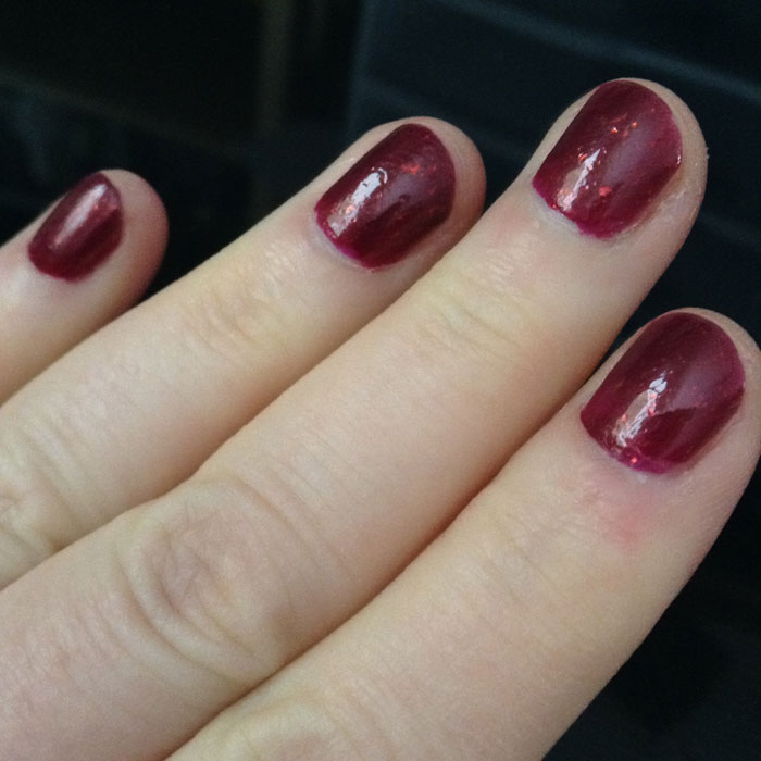 Iconic by Cult Nails -- a deep berry red with gold shimmer.