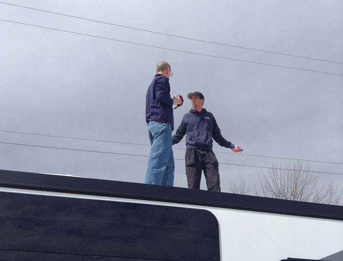 Getting a tour of the trailer, even the roof.