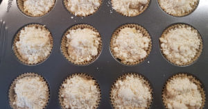 Add approximately 1 tbsp of topping to each muffin top.