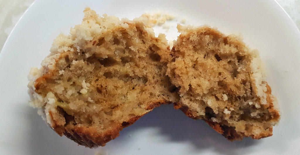 A banana crumb muffin cut in half.