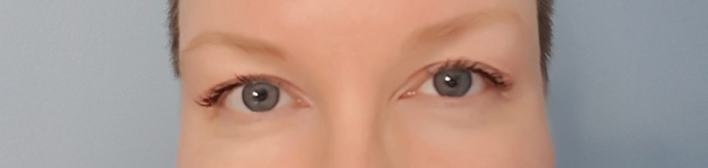 Moe with L'Oreal Voluminous Mascara applied to both eyes.