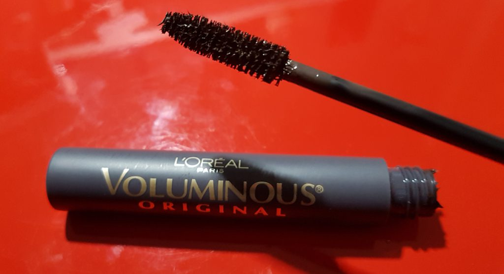 A tube of L'Oreal Voluminous Mascara open and showing brush.